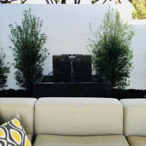 Fountain behind outdoor couch