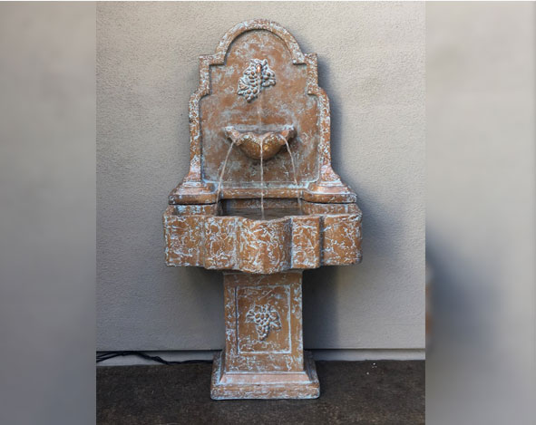 wall fountain with pedestal